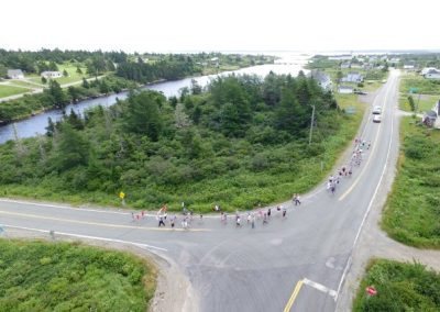 "Tor Bay Acadien Society - 2016 Festival Savalette: Tintamarre marchers heading dwn ""la butte du pungue (pont)"""