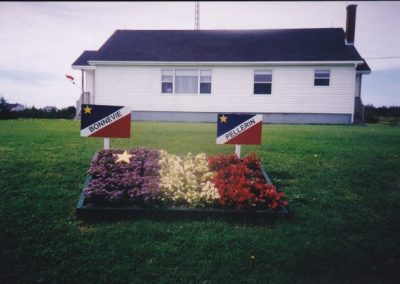 Tor Bay Acadien Society - Acadian Flag Flower Bed – created by Helen and Grayce Pellerin