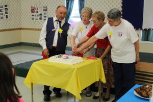 Tor Bay Acadiens Society - SARTB Executive cake cutting at opening ceremony