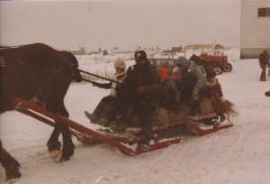 Tor Bay Acadien Society - Joe McGirr with a sleigh full of enthusiasts